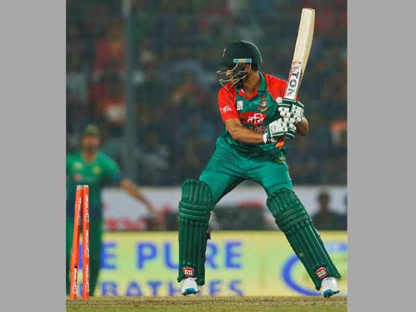 Shakib Al Hasan is about to hit the stumps after being bowled by Mohammad Aamir