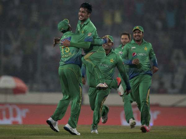 Mohammad Aamir (2nd left) celebrates a wicket with teammates during the Asia Cup