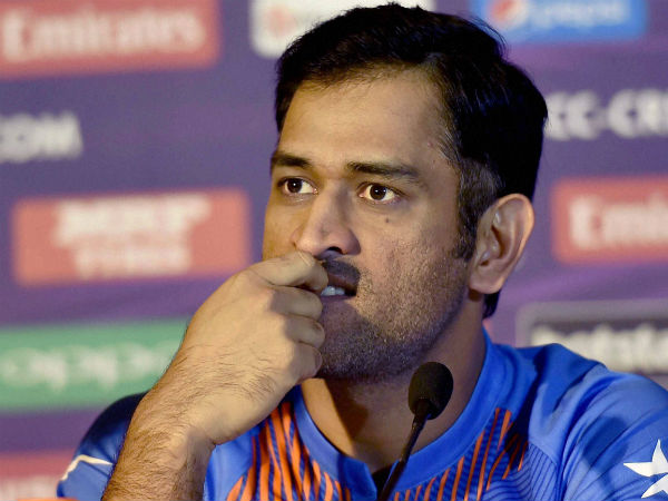 MS Dhoni is photographed during a press conference in Kolkata on Tuesday