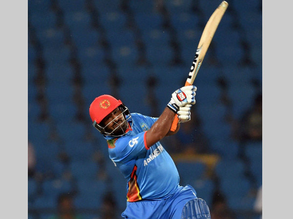 Afghanistan's Mohammad Shahzad plays a shot against Hong Kong. He scored 41