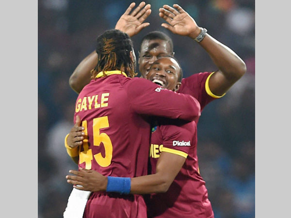 Chris Gayle (left) celebrates with his teammates after dismissing Rilee Rossouw during their World T20 match