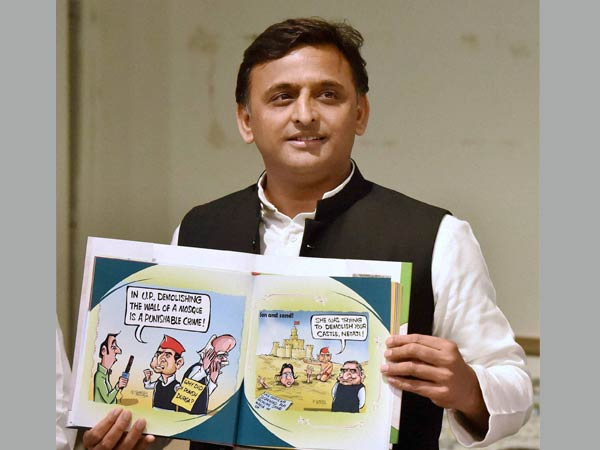 "Uttar Pradesh Chief Minister Akhilesh Yadav releases a book ""Tipu ka Afsana"" based on cartoons on him at Samajwadi Party headquarters in Lucknow on Monday."