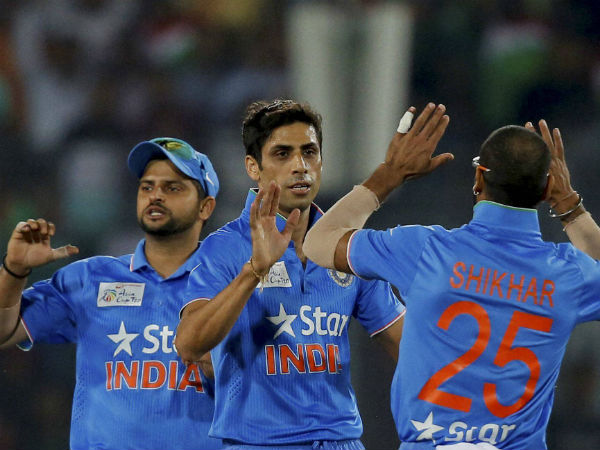 Nehra (centre) celebrates with Shikhar (right) and Raina after dismissing Sarkar in the final