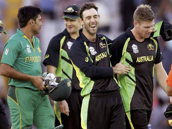 Glenn Maxwell (2nd right) reacts with team-mate James Faulkner (right) after Australia beat Pakistan in Mohali