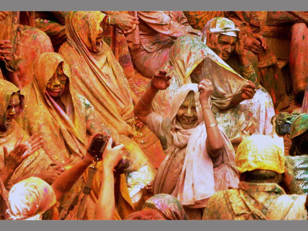 Hundreds of widows play Holi at Gopinath temple in Vrindavan on Monday.