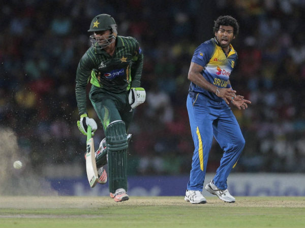 Lasith Malinga (right) is out of World T20