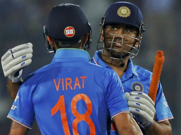 MS Dhoni (right) and Virat Kohli celebrate India's Asia Cup title win