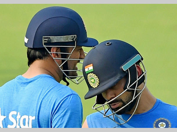 Dhoni (left) and Kohli at practice during World T20