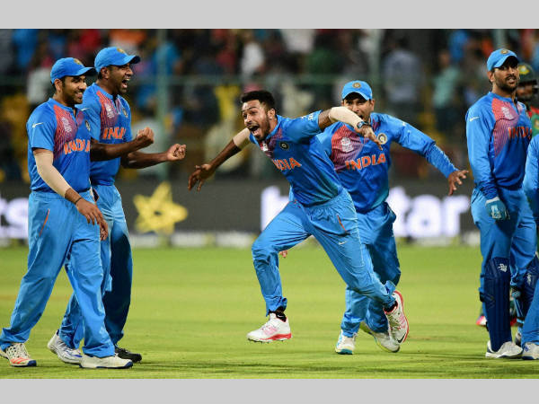 MS Dhoni (right) remains calm and composed while his team-mates break into celebrations after India's 1-run win