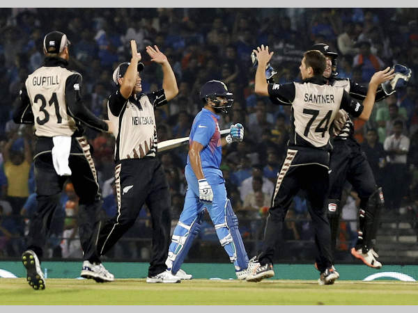 New Zealand players celebrate the dismissal of Rohit Sharma in Nagpur