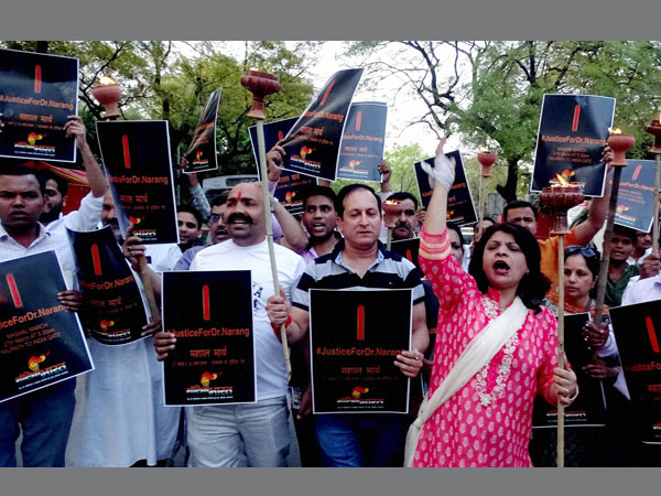 People take part in a candle march against the heinous killing of dental surgeon Pankaj Narang at Jantar Mantar in New Delhi on Sunday.