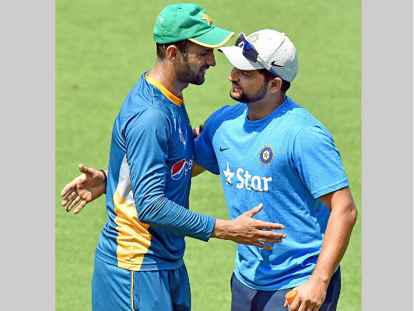 Raina (right) and Malik greet each other during practice at Eden Gardens