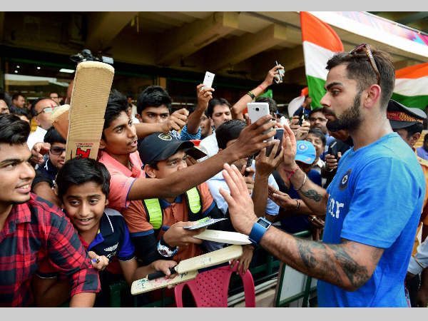 Virat Kohli obliges his fans in Bengaluru during the World T20