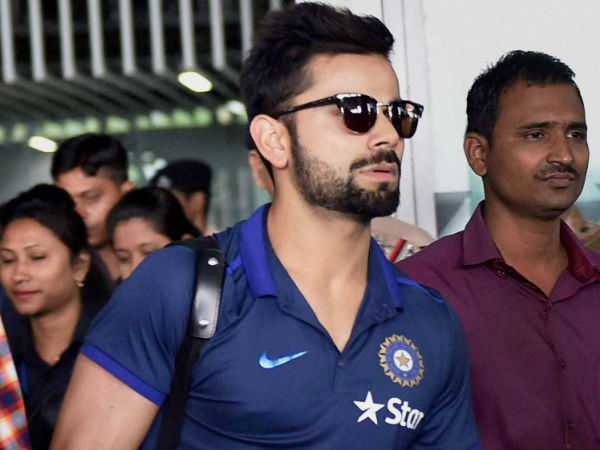 Virat Kohli (left) arrives in Kolkata on Monday (March 7) for World T20, from Bangladesh, after winning the Asia Cup