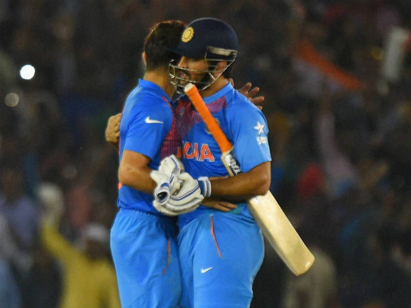 Kohli and Dhoni (right) embrace after the success