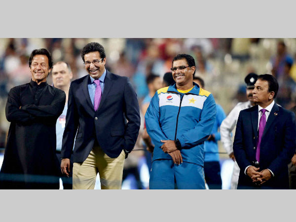 Wasim Akram (2nd left) shares a light moment with Imran Khan (left), Pakistan coach Waqar Younis (2nd right) as Sunil Gavaskar (right) looks on at Kolkata's Eden Gardens before the India-Pakistan WT20 match on March 19