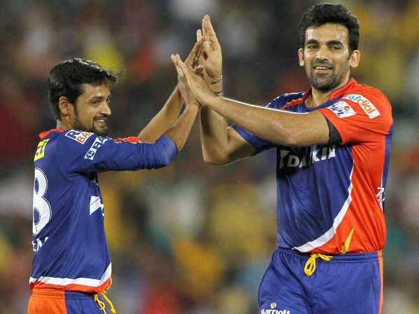 File photo: DD's Zaheer Khan (right) celebrates a wicket with his team-mate Shahbaz Nadeem during last year's IPL match against Chennai Super Kings in Raipur on May 12, 2015