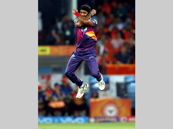 Ashok Dinda celebrates after dismissing David Warner