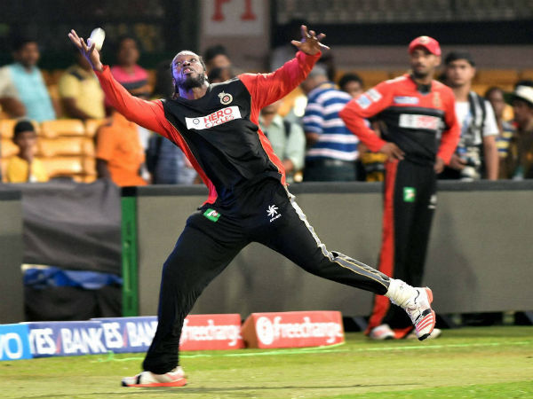 Chris Gayle (left) takes a catch during RCB's training session in Bengaluru recently