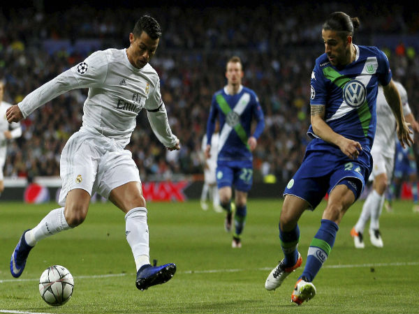 Cristiano Ronaldo fights for the ball against Wolfsburg's Ricardo Rodriguez during the Champions League 2nd leg quarterfinal soccer match between Real Madrid and VfL Wolfsburg.