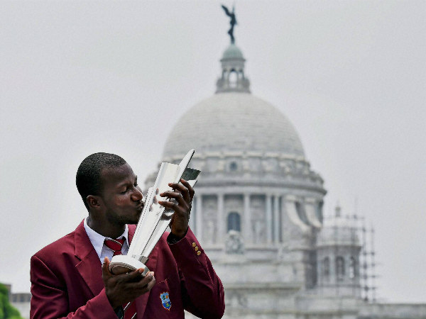 West Indies captain Darren Sammy kisses the World T20 trophy in front of Victoria Memorial in Kolkata on Monday (April 4).