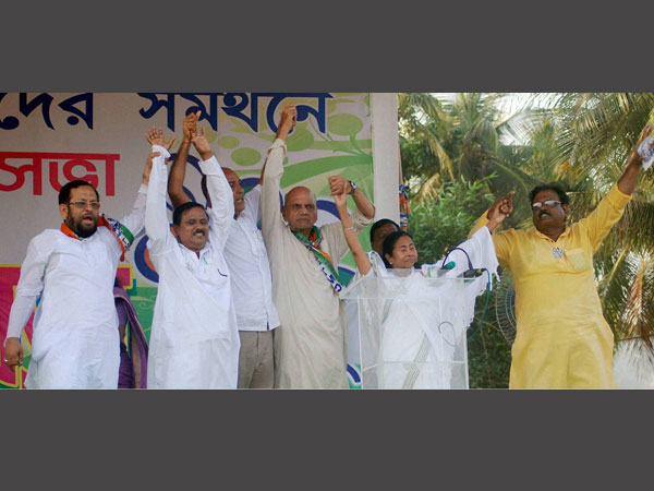 Mamata Banerjee at a rally with TMC leaders