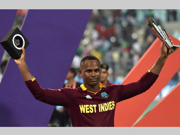 Marlon Samuels poses with his Man-of-the-match award after the World T20 final