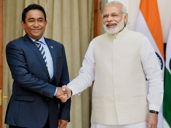 Prime Minister Narendra Modi shakes hands with President of Maldives Abdulla Yameen Abdul Gayoom during their meeting at Hyderabad house in New Delhi.