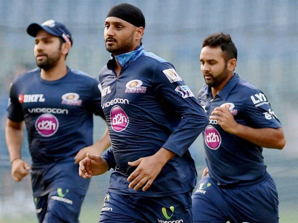 File photo: Mumbai Indians' players Rohit Sharma (left), Harbhajan Singh (centre) and Parthiv Patel run during a training session
