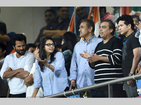 Sachin Tendulkar (right) and other dignitaries watch the India-West Indies semi-final in Mumbai