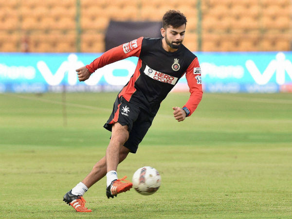 RCB captain Virat Kohli plays football during the team's training session in Bengaluru on Monday (April 10)