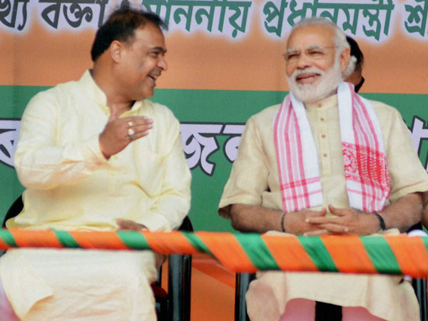 Prime Minister Narendra Modi with Senior BJP leader Himanta Biswa Sarma (L) during an election rally in Sonitpur district of Assam