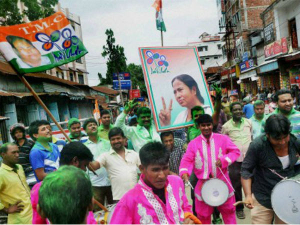 TMC supporters celebrate the party's win in WB polls