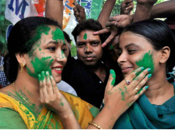 TMC workers smear color on each other in Kolkata