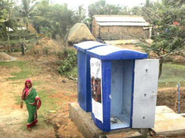 Poop in hand, Bill Gates backs China's toilet revolution