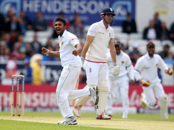 Sri Lanka's Dasun Shanaka celebrates taking the wicket of England's Alastair Cook, centre, during day one of the first cricket Test against England at Headingley
