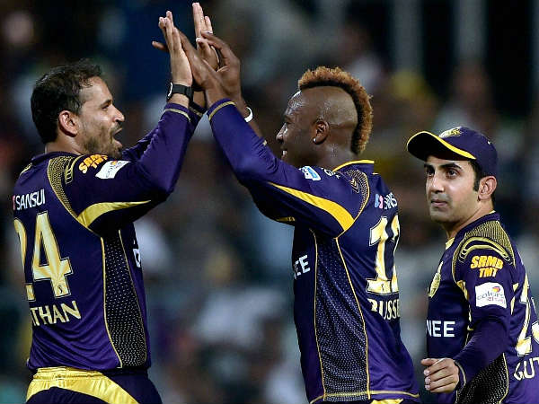 Andre Russell (centre) celebrates with Yusuf Pathan (left) after dismissing Kings XI Punjab's Marcus Stoinis as Gautam Gambhir looks on