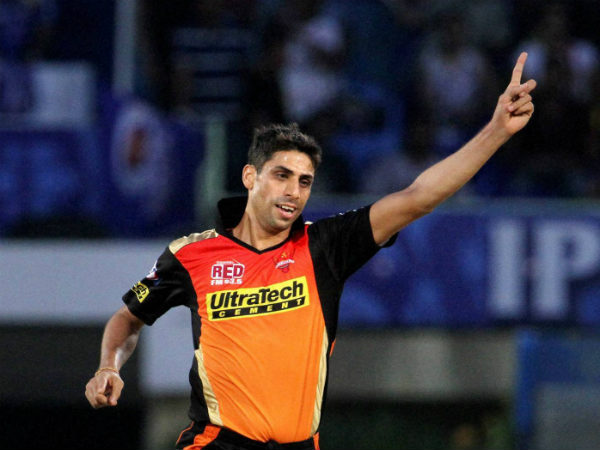 Ashish Nehra celebrates after dismissing Jos Buttler