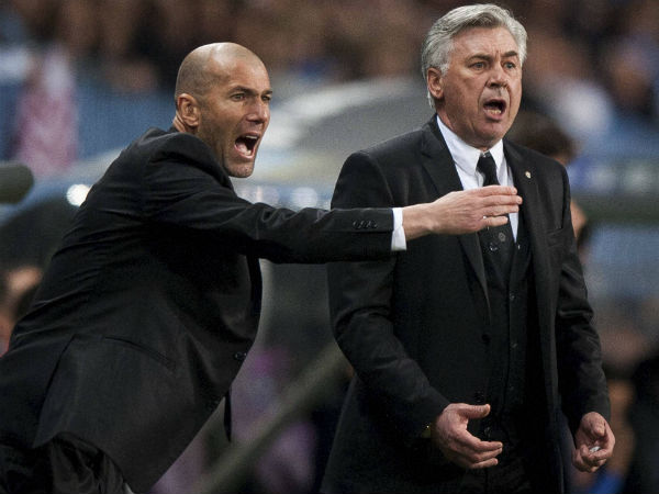 Real Madrid's assistant coach Zinedine Zidane from France, left, and coach Carlo Ancelotti from Italy.