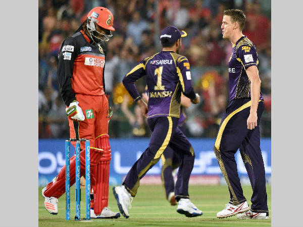 Another failure: Gayle (left) is dismissed by Morne Morkel (right) of Kolkata Knight Riders for 7 in Bengaluru on May 2