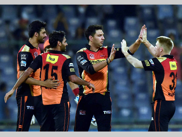 Warner (right) and his team-mates celebrate SRH's win over KKR