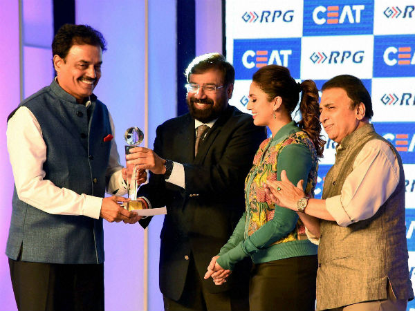 Industrialist Harsh Goenka, bollywood actress Huma Qureshi and former cricketer Sunil Gavaskar present the life time achievment CEAT Cricket Rating award to former Indian cricketer Dilip Vengsarkar in Mumbai on Monday.