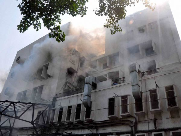 Smoke billowing out after a fire broke out at the Times of India building in ITO area in New Delhi.