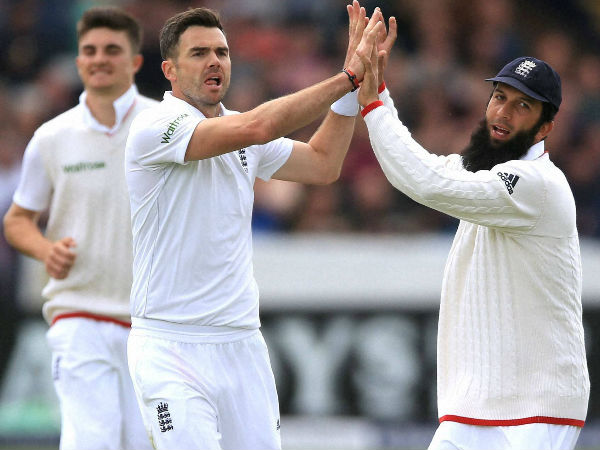 England's James Anderson, centre, celebrates with Moeen Ali after taking the wicket of Sri Lanka's Kaushal Silva during the first Test at Headingley, Leeds, England, on May 21