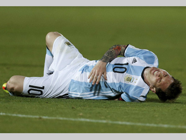 File photo: Lionel Messi grimaces after being fouled during a 2018 Russia World Cup qualifying soccer match against Chile at the National Stadium in Santiago, Chile, Thursday, March 24, 2016.