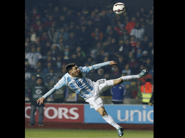 Argentina's Lionel Messi kicks the ball during a Copa America semifinal soccer match against Paraguay at the Ester Roa Rebolledo Stadium in Concepcion, Chile, Tuesday, June 30, 2015.