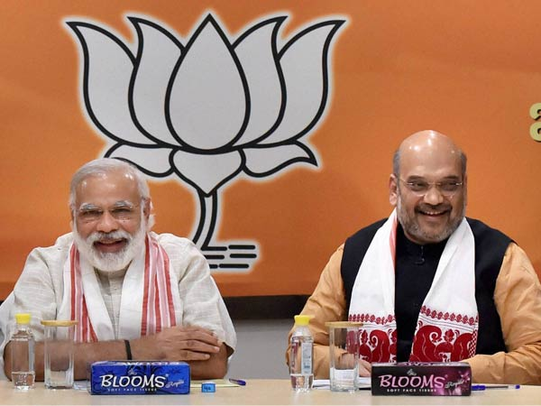 Prime Minister Narendra Modi with BJP President Amit Shah at a meeting at the party office in New Delhi on Thursday after Assembly poll results.