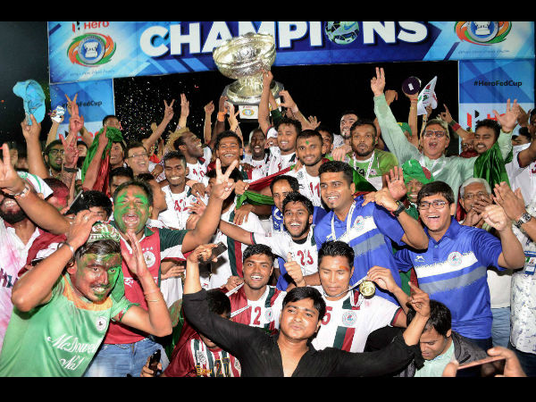Players and officials of Mohan Bagan with winning trophy of Federation Cup 2016 after defeating Aizwal Football Club at Indira Gandhi Athletics Stadium, Sarusajai in Guwahati on Saturday. Mohan Bagan won by 5-0.