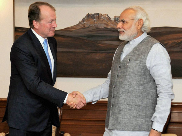 File Photo: Prime Minister Narendra Modi shakes hands with Chairman, CISCO, John Chambers during a meeting in New Delhi.