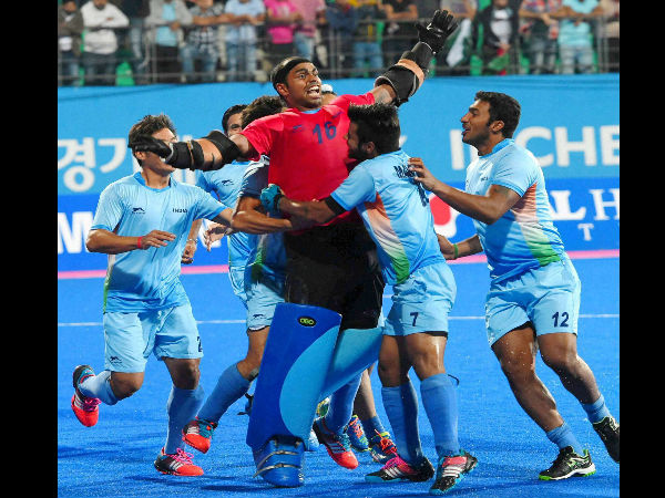 Indian hockey goalkeeper Sreejesh celebrate with team mates